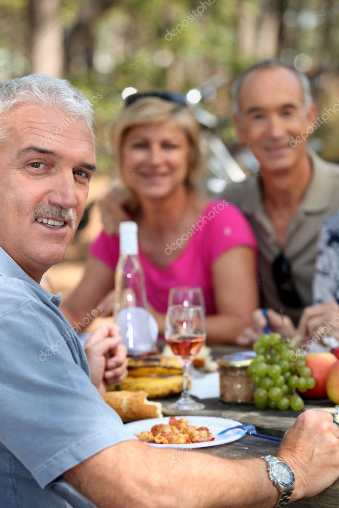 Three seniors having lunch in the country  Stock Photo #7892170