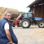 Famer stood by hay barn — Stock Photo #7902542
