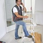 Artisan or handyman at phone — Stock Photo