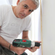 Grey-haired DIY enthusiast — Stock Photo #7903366