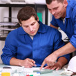 Two laborers in office — Stock Photo