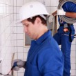 Electricians wiring a bathroom — Stock Photo