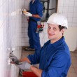 Two electrician working on restroom — Stock Photo