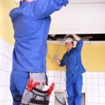 Duo of plumbers indoors — Stock Photo