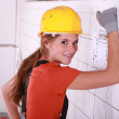 Female electrician in a tiled room — Stock Photo #7903934