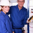 Young female apprentice electrician — Stock Photo #7904002