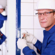 Electrician wiring a wall socket — Stock Photo #7904012