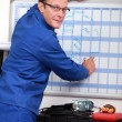 Technician completing planning — Stock Photo