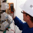 Foto Stock: Electrical inspector reading power output