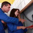 Plumber instructing his apprentice — Stock Photo #7904099