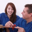 Young female apprentice and instructor — Stock Photo #7904161