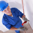 Stock Photo: Smiling laborer installing piping