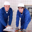Two men do DIY - Stock Photo