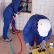 Workers repairing pipes — Stock Photo #7904363