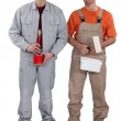 A team of painters standing side-by-side — Stock Photo
