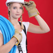 Young tradeswoman giving a salute — Stockfoto