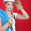 Young tradeswoman giving a salute — Stock Photo