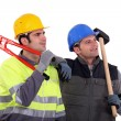 Construction workers, studio shot — Stock Photo