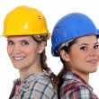 Stock Photo: Tradeswomen standing back to back
