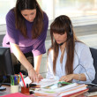 Two women working in the office — Stock Photo