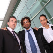 Business trio outside an office building — Stock Photo #7904884