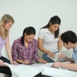 Team discussing drawings — Stockfoto
