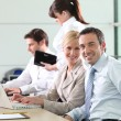 Colleagues working in an office — Stock Photo #7905247