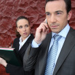 A manager at phone and his assistant — Stock Photo
