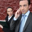 A manager at phone and his assistant — Stock Photo #7905366