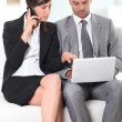Couple with phone and laptop — Stock Photo #7905426