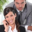 Portrait of an executive couple - Stock Photo