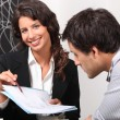 Businesswoman discussing a contract with her client - Foto de Stock
