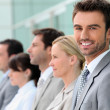 Businesspeople stood in a row — Stock Photo
