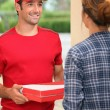 Stock Photo: Mdelivering pizza