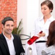 Sommelier presenting wine to restaurant patron — Stock Photo #7906018