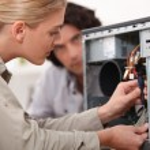 Woman fixing a computer hard drive — Stock Photo