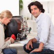 Couple repairing broken television — Stock Photo