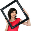 Woman holding herself within a picture frame — Stock Photo