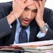 Stressed young businessman — Stock Photo