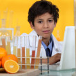 Young boy in laboratory — Stock Photo