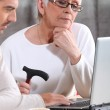 Elderly woman learning internet skills — Stock Photo #7906759