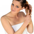 Woman taking care of her hair — Stock Photo