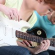 Girl learning to play guitar — Stock Photo #7907480