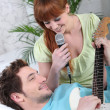 Young couple with a guitar and a microphone - Foto Stock