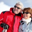 Old couple skiing — Stock Photo