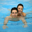 Couple swimming in pool — Stock Photo