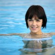 Attractive brunette in pool — Stock Photo #7908132