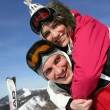 Stock Photo: Young couple messing around on ski slopes