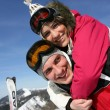 Young couple messing around on the ski slopes — Stock Photo