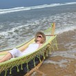Stock Photo: Woman relaxing on the beach